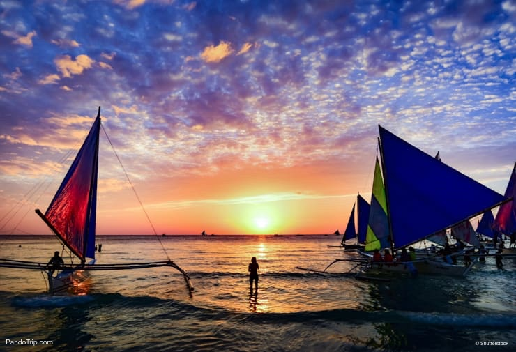 Sunset Sailing at the famous White Beach of the Boracay Island, Philippines