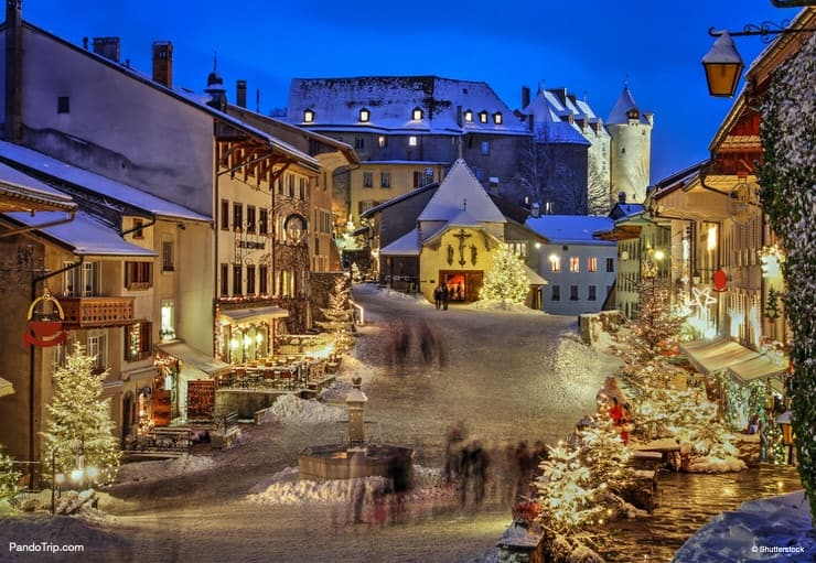 Christmas night scene in the medieval town of Gruyeres, Switzerland