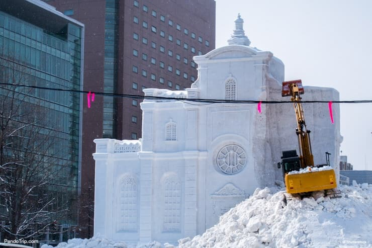 Demolition of snow sculptures immediately after Sapporo Snow Festival. Sapporo, Hokkaido, Japan