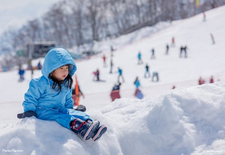 Girl playing with snow at Gala Yuzawa in Japan