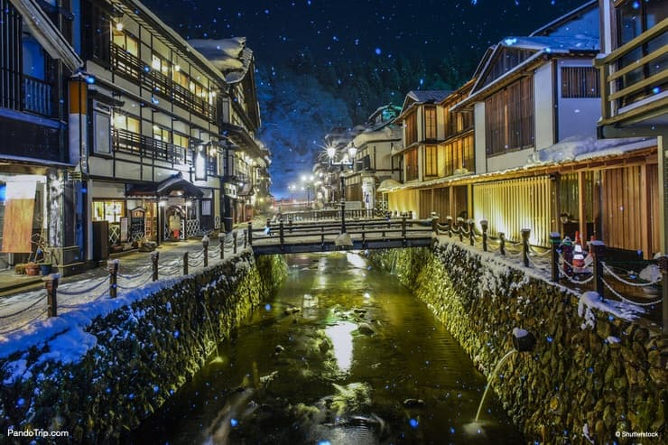 Historic ryokan lined up along the Ginzan River, Ginza Onsen, Japan
