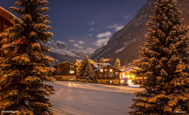 Winter night over Tasch valley, the gate to Zermatt, Switzerland