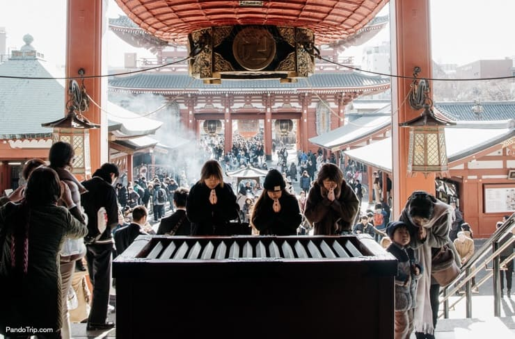 People praying at Praying at Senso-ji Temple in Asakusa